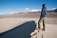 Person takes in view of desert landscape from Eureka dunes, Death Valley national park, California