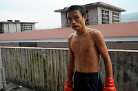 Li Le Fa, 15, after a bout in Huili Middle School in Sichuan Province, China. The group of young boxers are hoping to make it to become some of China's first professional boxers...PHOTO BY SINOPIX