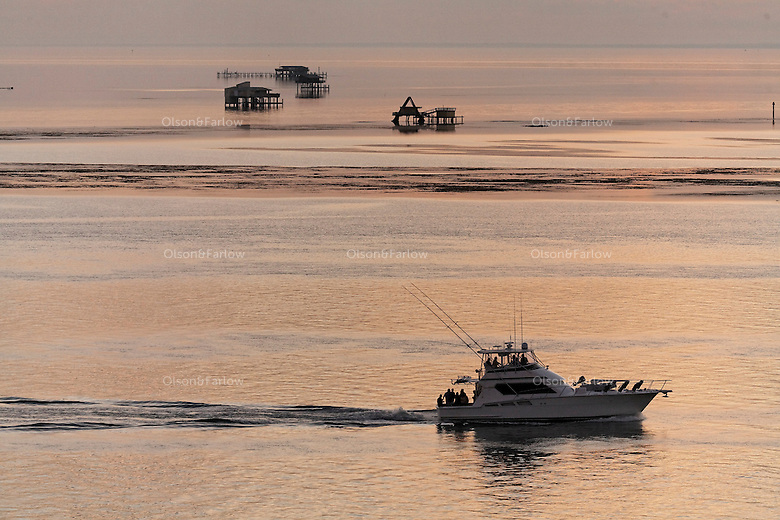 Stiltsville, abandoned homes on stilts off the beach at Bill Baggs State Park. Sunset, boats and beach scenes.