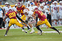 LOS ANGELES, CA-OCTOBER 29,2011- Stanford defeated USC 56-48. Griff Whalen (17)pushes forward with the ball during play against USC at the L.A. Coliseum in Los Angeles, CA.
