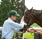 Trainer Todd Wyatt pats Sneaky Louis after winning the 5th.