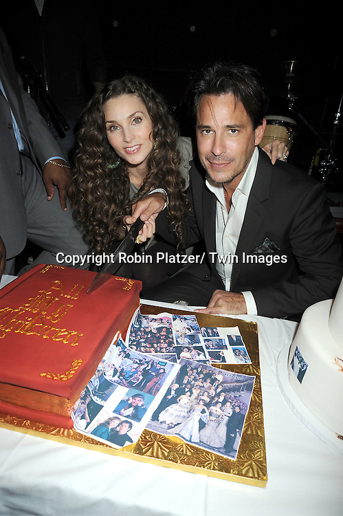 Alicia Minshew and  Ricky Paull Goldin with the cake attending the Good Night Pine Valley Event co-hosted by All My Children actors Ricky Paull Goldin and Alicia Minshew on September 17, 2011 at Prohibition in New York City