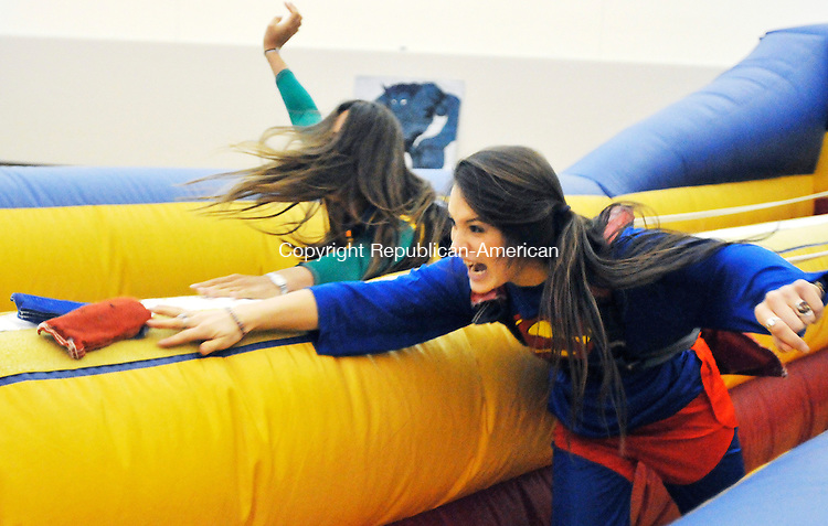 MIDDLEBURY, CT- 11 JANUARY 2008 --011109JS12-FOR COUNTRY LIFE-Westover students, Claire Murphy of Fairfield, right, battles classmate Sara Arno of Rhinebeck, NY in the bungee run during the annual Dorcas Fair held Sunday at the Westover School, The event, now in its 100th year, is a fundraiser organized by the junior class. Money raised from the event is donated to charitable groups.<br /> Jim Shannon / Republican-American
