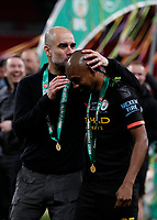 1st March 2020; Wembley Stadium, London, England; Carabao Cup Final, League Cup, Aston Villa versus Manchester City; Manchester City Manager Pep Guardiola kissing Fernandinho of Manchester City head in celebration while wearing a winners medal