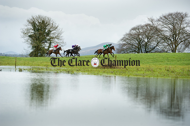 Horses and riders traverse the open countryside at the East Clare Harriers Hunt Point To Point at Garranboy, Killaloe. Photograph by John Kelly.