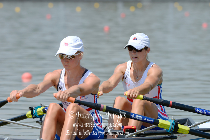 Chungju, South Korea. GBR LW2X, Bow Kathryn TWYMAN and Imogen WALSH, at the start of their heat at the 2013 FISA World Rowing Championships,  Tangeum Lake International Regatta Course. 12:34:01  Sunday  25/08/2013 [Mandatory Credit. Peter Spurrier/Intersport Images]