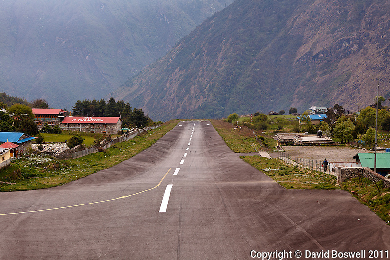 The short, 2000 ft. sloped runway makes landings and take-offs quite an adventure at Lukla Airport in the Himalaya Mountains of Nepal.
