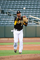 Luis Jimenez (7) of the Salt Lake Bees throws to first against the Tacoma Rainiers in Pacific Coast League action at Smith's Ballpark on July 8, 2014 in Salt Lake City, Utah.  (Stephen Smith/Four Seam Images)