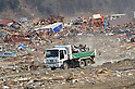 April 2nd, 2011, Rikuzentakata, Japan - A truck loaded with junk moves through the fields of debris in Rikuzentakata City, Iwate Prefecture, on April 2, 2011, three weeks after this Japanese coastal city was wiped out by a tsunami that followed a magnitude 9.0 earthquake. Rikuzentakata was one of the worst-hit town in the entire northeastern region. (Natsuki Sakai/AFLO) [3615] -mis-...