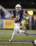 Nevada quarterback Tyler Stewart scrambles during an NCAA college football game against UC Davis in Reno, Nev. on Thursday, Sept. 3, 2015. (AP Photo/Cathleen Allison)