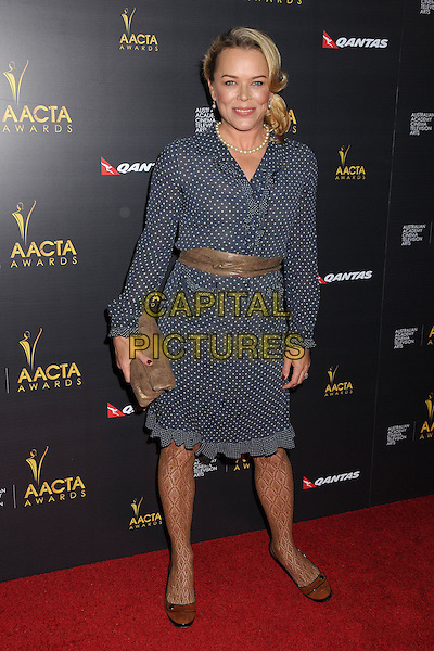 Kym Wilson.Australian Academy of Cinema and Television Arts 2nd Annual AACTA International Awards held at Soho House, West Hollywood, California, USA, 26th January 2013th..full length blue white polka dot dress brown belt clutch bag tights ruffle shirt .CAP/ADM/BP.©Byron Purvis/AdMedia/Capital Pictures.
