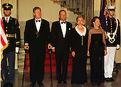 "Formal ""Grand Staircase"" photo in the Grand Foyer in The White House in Washington, D.C. on April 8, 1997. (L-R) United States President Bill Clinton, Prime Minister Jean Chrétien of Canada,  first lady Hillary Rodham Clinton, and Aline Chretien, wife of the Prime Minister..Credit: Ron Sachs / CNP"