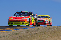 Jun. 21, 2009; Sonoma, CA, USA; NASCAR Sprint Cup Series driver Jeff Gordon (24) leads Marcos Ambrose during the SaveMart 350 at Infineon Raceway. Mandatory Credit: Mark J. Rebilas-