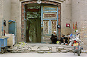 Old men sit near a side entrance to Id Kah Mosque in Kashgar.