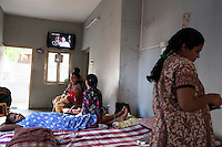 Surrogates laze around and chat with each other, as they spend the entire pregnancy, in the surrogate's house in Anand, Gujarat, India on 11th December 2012. Photo by Suzanne Lee / Marie-Claire France