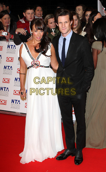 Sarah Jayne Smith and Matt Smith.arrivals at The National Television Awards, O2 Greenwich, London, England. 25th January 2012.NTA NTAS full length black dress suit white blue shirt hand on hip .CAP/ROS.©Steve Ross/Capital Pictures.