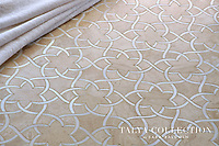 Isidore, a stone waterjet mosaic shown in Allure honed and Snow White polished, is part of the Talya Collection by Sara Baldwin for Marble Systems.