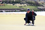 WILMINGTON, NC - MARCH 19: Kent State's Bjarki Petursson (ISL) lines up a putt on the Ocean Course eighth hole. The first round of the 2017 Seahawk Intercollegiate Men's Golf Tournament was held on March 19, 2017, at the Country Club of Landover Nicklaus Course in Wilmington, NC.