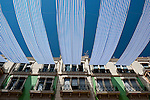 Summer fabric sunshades on residential building. Alicante City, Costa Blanca, Spain, Europe.