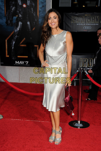 "KATIE CLEARY .""Iron Man 2"" World Premiere held at the El Capitan Theatre, Hollywood, California, USA, 26th April 2010..arrivals full length silver dress sleeveless hand on hip shiny open toe grey gray patent sandals clutch bag red .CAP/ADM/BP.©Byron Purvis/AdMedia/Capital Pictures."
