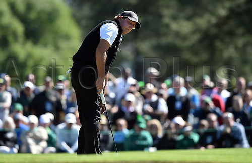 07.04.2016. Augusta, GA, USA. Phil Mickelson putts on the second green during the first round of the Masters Golf Tournament on Thursday, April 7, 2016, at Augusta National Golf Club in Augusta, Ga