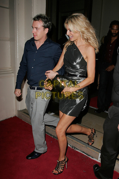 TESS DALY & GUEST.Leaving the GQ Men of the Year Awards at the Royal Opera House, Covent Garden, London, England..September 2nd 2008.departures full length one grey gray silver shoulder dress black zip up Jimmy Choo sandals shoes clutch bag shiny patent.CAP/AH.©Adam Houghton/Capital Pictures.