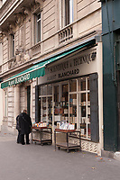 Two people browse at the Albert Blanchard bookstore - specializing in Scientific and Technical books - in Paris.