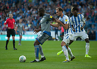 Lincoln City's John Akinde shields the ball from Huddersfield Town's Jon Gorenc Stankovic<br /> <br /> Photographer Andrew Vaughan/CameraSport<br /> <br /> The Carabao Cup First Round - Huddersfield Town v Lincoln City - Tuesday 13th August 2019 - John Smith's Stadium - Huddersfield<br />  <br /> World Copyright © 2019 CameraSport. All rights reserved. 43 Linden Ave. Countesthorpe. Leicester. England. LE8 5PG - Tel: +44 (0) 116 277 4147 - admin@camerasport.com - www.camerasport.com