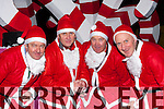 Santa's helpers Seamus O'Donoghue, Donal Whitty O'Sullivan, Dan McAulliffe and Pat Teahan at the Christmas in Killarney parade on Friday night