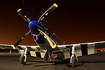 TF-51D Mustang 'Lady Jo' owned by Darryl Bond sits under the nightime sky at Sacramento Executive Airport during a Mustang gathering hosted by Dream Machines on January 30th, 2009. Lady Jo is a regular participant at the Reno National Championship Air Races each September in Nevada.