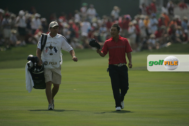 Anthony Kim and caddy walking down the 7th fairway after Sergio Garcia put two balls in the water from the island fairway  on the 7th hole during the final round of Single Matches at The 37th Ryder cup from Valhalla Golf Club in Louisville, Kentucky....Photo: Fran Caffrey/www.golffile.ie.