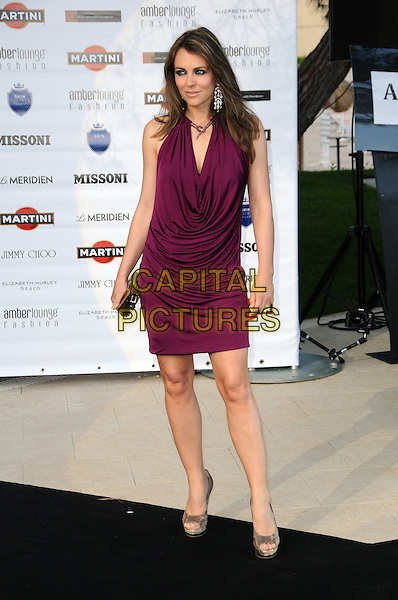 ELIZABETH HURLEY .Amber Lounge party held at the Meridien Beach Plaza  in Monte Carlo, Monaco, .May 14th, 2010 .full length Liz purple aubergine dress cowel neck ruched halterneck clutch bag necklace open toe platform shoes silver grey gray .CAP/CAS.©Bob Cass/Capital Pictures.