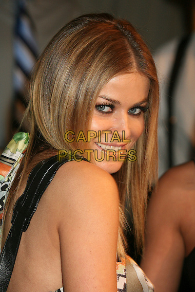 CARMEN ELECTRA.Bartles & Jaymes Poolside BBQ at the Roosevelt Hotel, Hollywood, California, USA..May 10th, 2007.headshot portrait looking over shoulder .CAP/ADM/BP.©Byron Purvis/AdMedia/Capital Pictures