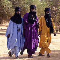 Akadaney, Central Niger, West Africa.  Fulani Nomads. Men Walking, Mouths Veiled in the Tuareg Fashion.  Annual Gathering, Geerewol.