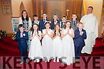 Pupils from Scoil Bhreanainn Portmagee who made their 1st Holy Communion on Saturday in St Patricks Church, Portmagee pictured here front l-r; David Kennedy, Chloe Devane, Niamh Dennehy, Niamh Moran, Leanne O'Connor, Jack Keating, Louise Kesting(teacher), Naoise Sugrue, Darragh O'Sullivan, Luke O'Sullivan, Evan O'Sullivan, Thomas Curran & Fr. David Gunn.