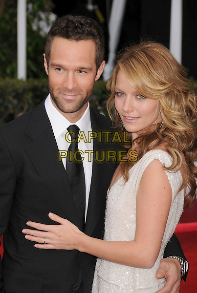 CHRIS DIAMANTOPOULOS & BECKI NEWTON.14th Annual Screen Actors Guild Awards held at the Shrine Auditorium, Los Angeles, California, USA..January 27th, 2008.SAG red carpet arrivals half length black suit white dress layers layered married husband wife .CAP/ADM/BP.©Byron Purvis/AdMedia/Capital Pictures. *** Local Caption *** .