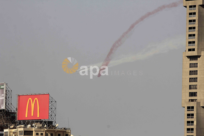 Egyptian air force planes participate in an air parade during a celebration marking the airforce day, in Cairo on October 14, 2015. Photo by Stringer