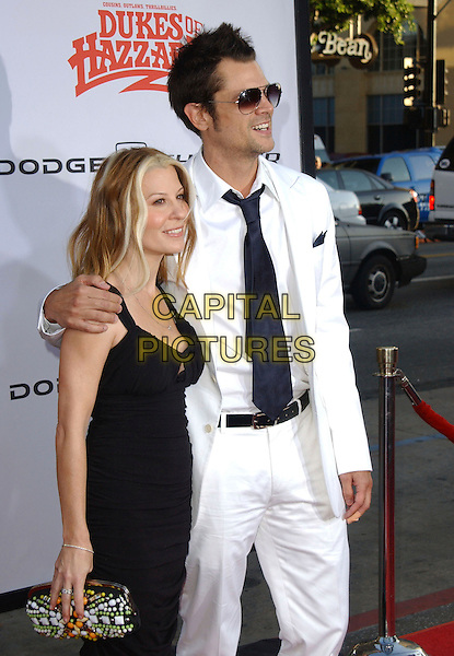 "MELANIE KNOXVILLE & JOHNNY KNOXVILLE .The Warner Brothers World Premiere of ""The Dukes of Hazzard"" held at The Grauman's Chinese Theatre in Hollywood, California  .July 28th, 2005.half length married husband wife white suit arm over shoulder blue tie sunglasses shades beaded clutch purse.www.capitalpictures.com.sales@capitalpictures.com.Supplied By Capital PIctures"
