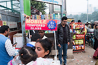 People gather around street vendors at HUDA City Centre in Gurugram, Haryana, India, on Mon., December 10, 2018.