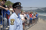 Niagara Falls, Ontario, Canada - 01 August 2006---A provincial offences officer of the Niagara Parks Police, supervising tourists / visitors  lining up for a cruise on the Niagara River---people, tourism---Photo: © HorstWagner.eu