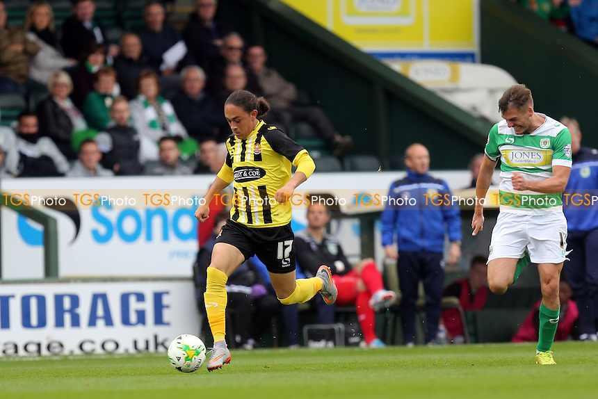 Jodi Jones of Dagenham and Ryan Dickson of Yeovil Town during Yeovil Town vs Dagenham and Redbridge, Sky Bet League 2 Football at Huish Park, Yeovil, England on 10/10/2015