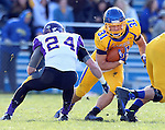 BROOKINGS, SD - OCTOBER 26:  Zach Zenner #31 from South Dakota State University looks for room past Tim Kilfoy #24 from Northern Iowa in the second quarter of their game Saturday afternoon at Coughlin Alumni Stadium in Brookings. (Photo by Dave Eggen/Inertia)