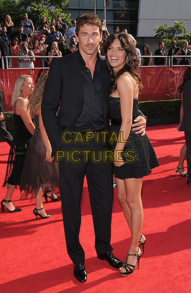 MARKO JARIC & ADRIANA LIMA.The 2008 ESPY Awards held at The Nokia Center in Los Angeles, California, USA..July 16th, 2008              .full length marco black suit blue shirt dress ruffled ruffles clutch bag hand in pocket couple                                                        .CAP/DVS.©Debbie VanStory/Capital Pictures.