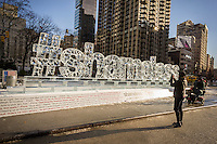 "Passer by amuse themselves with an ice sculpture promoting the Showtime series ""Shameless"" is displayed in Madison Square in New York on Friday, January 9, 2015. The fifth season of the cable television show starts on Sunday.   (© Richard B. Levine)"