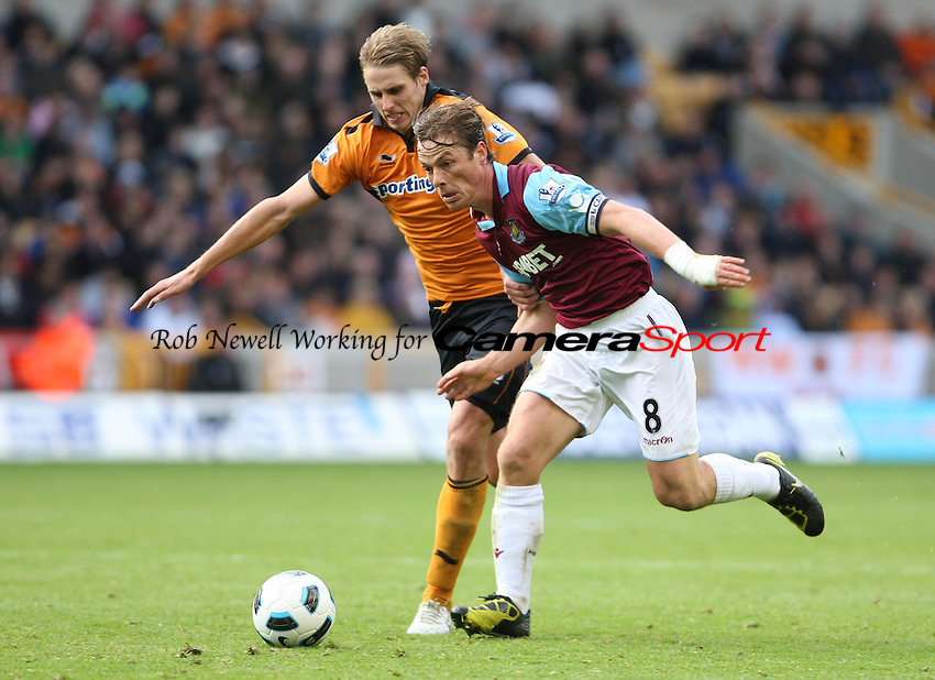Scott Parker of West Ham takes on David Edwards of Wolves - Wolverhampton Wanderers vs West Ham United, Barclays Premier League at Molineaux, Wolverhampton - 16/10/10 - MANDATORY CREDIT: Rob Newell/TGSPHOTO - Self billing applies where appropriate - 0845 094 6026 - contact@tgsphoto.co.uk - NO UNPAID USE.