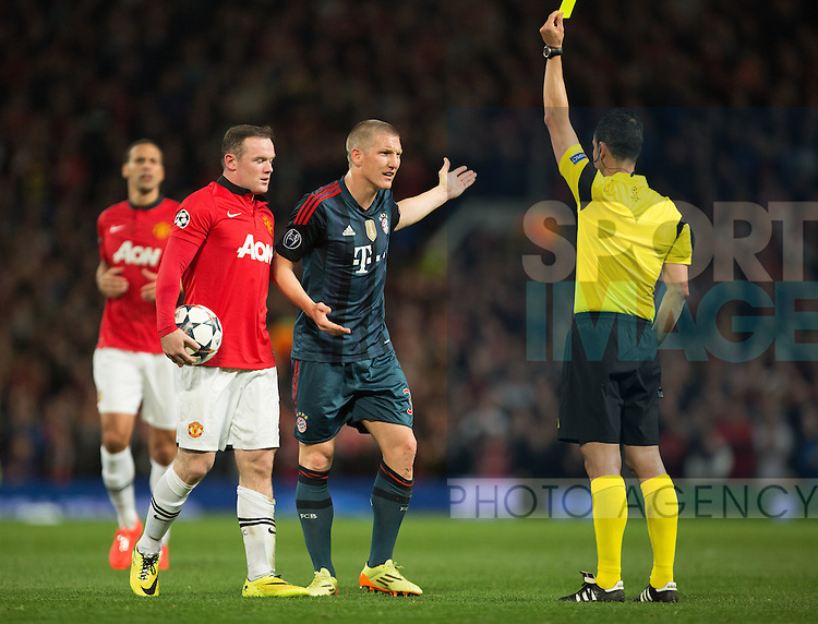 Bastian Schweinsteiger of Munich is shown a yellow card - UEFA Champions League - Manchester United vs. Bayern Munich - Old Trafford - Manchester - England - 1st April 2014 - Picture Philip Oldham/Sportimage