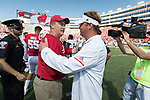Wisconsin Badgers Head Coach Paul Chryst, left, shakes hands with Florida Atlantic Owls Head Coach Lane Kifflin after an NCAA College Football game Saturday, September 9, 2017, in Madison, Wis. The Badgers won 31-14. (Photo by David Stluka)