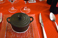 Carcassonne. At the Restaurant Auberge des Lices. Languedoc. Black cast iron pot with lid used for serving a pumpkin soup, soupe de potiron. France. Europe.