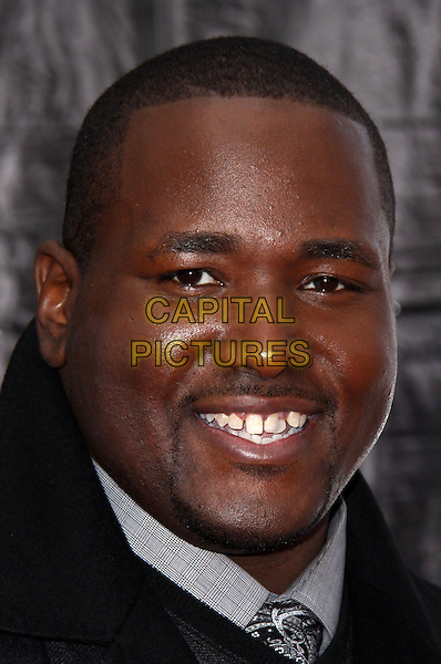 "QUINTON AARON .At the New York City Premiere of ""The Blind Side"" held at the Ziegfeld Theater, New York, NY, USA, .17th November 2009..portrait headshot smiling goatee facial hair grey gray tie teeth .CAP/ADM/PZ.©Paul Zimmerman/AdMedia/Capital Pictures."