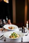 A waiter serves dinner at a restaurant in Tórshavn, the capital city of the Faroe Islands.